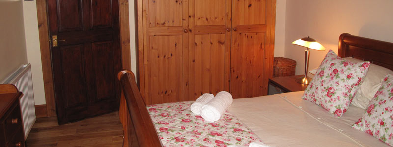 The double bedroom has a sleigh bed and double wardrobe