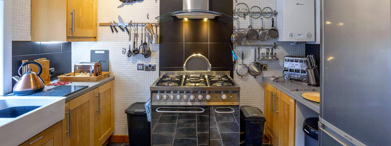 The Kitchen is well equipped with a six ring gas stove